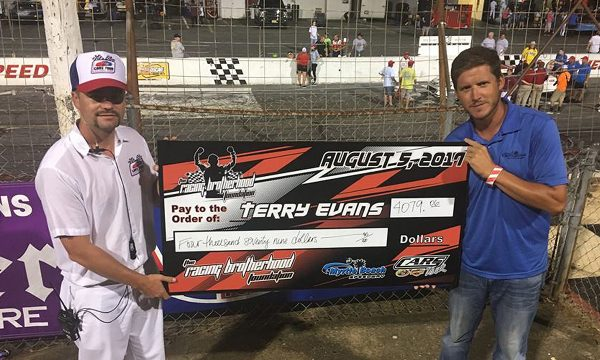 Over $9,000 Raised by Two Tracks in Memory of Terry Evans